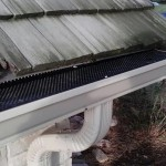Another angle of the gutter with leaf protection and downspout